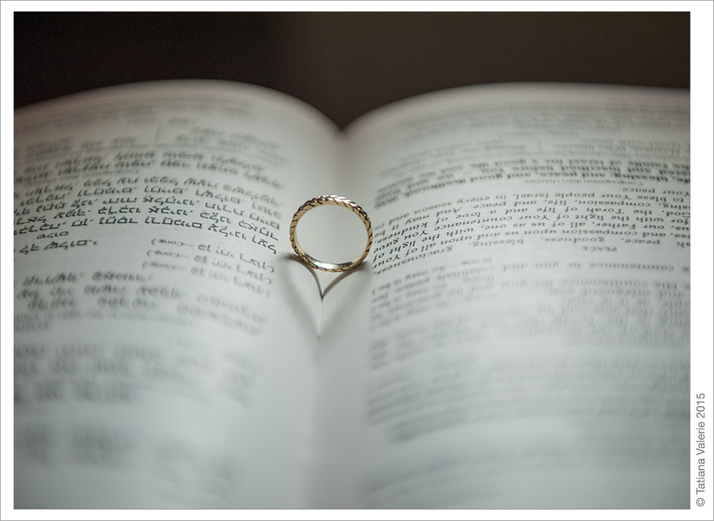 Wedding Ring on a Book Heart Shadow